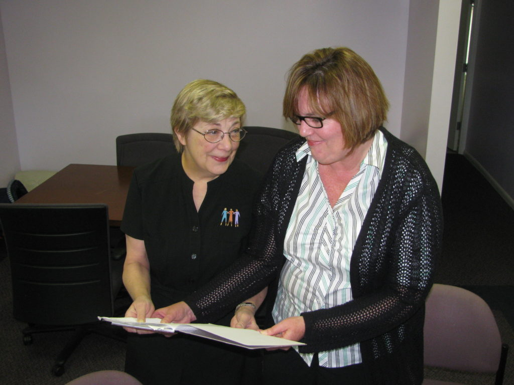 An ESC volunteer and a nonprofit employee working together